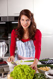 Healthy cooking. Beautiful young woman preparing vegetables for dinner Stock Photography