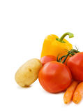 Healthy cooking with fresh vegetables. Potato, tomatoes, carrots and peppers. Isolated over white Stock Photo