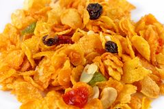 Healthy corn flakes mixed with dried cranberries and black raisi royalty free stock photo