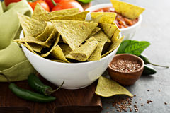 Healthy corn tortilla chips with spinach and flax seeds. Healthy green corn tortilla chips with spinach and flax seeds Stock Photography