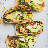 Healthy corn tortillas with grilled chicken fillet, avocado, fresh salsa Stock Photo