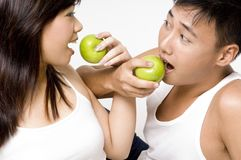 Healthy Couple 8. A healthy asian couple eating apples Stock Photography
