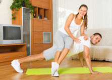 Healthy couple doing fitness. Happy couple doing fitness on mat and smiling Stock Image