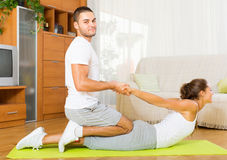 Healthy couple doing fitness. Healthy young couple doing fitness on mat Stock Photography