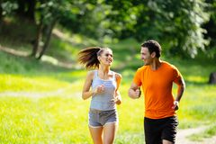 Healthy couple jogging in nature. In good spirit stock photos