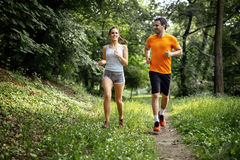 Healthy couple jogging in nature. In good spirit Royalty Free Stock Image