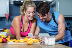 Healthy couple looking at smartphone Royalty Free Stock Photography