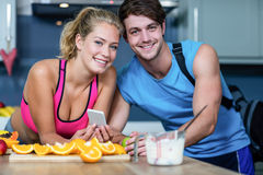 Healthy couple looking at smartphone Stock Image