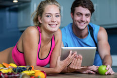 Healthy couple looking at tablet Royalty Free Stock Image