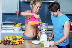 Healthy couple preparing a smoothie Royalty Free Stock Photo