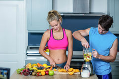 Healthy couple preparing a smoothie Stock Photography