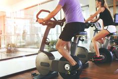 Healthy couple in a sport centre. Healthy couple training on a treadmill in a sport centre stock photos