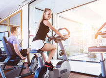 Healthy couple training on a treadmill in a sport center Royalty Free Stock Image