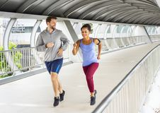 Healthy couple working out together Stock Images