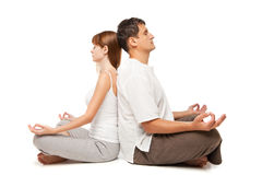 Healthy couple in yoga position on white Stock Image