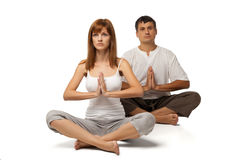 Healthy couple in yoga position on white Stock Photos