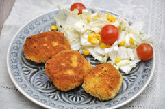 Couscous patties with salad Royalty Free Stock Image