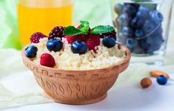 Healthy couscous salad with berries. Royalty Free Stock Photography