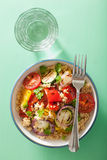 Healthy couscous salad with grilled tomato pepper zucchini onion Stock Photos