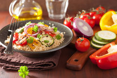 Healthy couscous salad with grilled tomato pepper zucchini onion Royalty Free Stock Photos