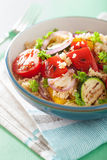 Healthy couscous salad with grilled tomato pepper zucchini onion Royalty Free Stock Photo