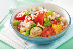 Healthy couscous salad with grilled tomato pepper zucchini onion Stock Photo
