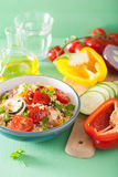 Healthy couscous salad with tomato pepper zucchini onion Stock Photos