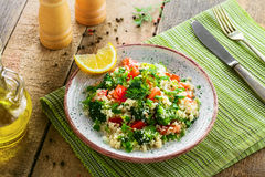 Healthy couscous salad with vegetables Stock Image