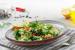 Healthy couscous salad with vegetables Stock Photo