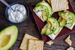 Healthy Crackers In Plate With Sour Cream, Thyme And Avocado Royalty Free Stock Photos