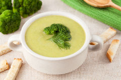 Healthy cream broccoli soup in a white dish Stock Image