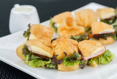 Healthy croissant sandwich. Closeup of healthy salad croissant sandwich resting Royalty Free Stock Photo