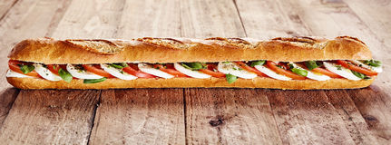 Healthy crusty baguette with mozzarella and tomato Stock Photo
