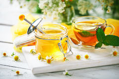 A healthy Cup of tea, a jar of honey and flowers. Selective focus. Royalty Free Stock Images