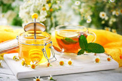 A healthy Cup of tea, a jar of honey and flowers. Selective focus. Stock Photography