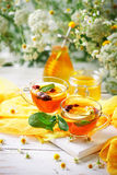 A healthy Cup of tea with lemon, rosehip, mint and flowers. Selective focus. Royalty Free Stock Image