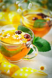 A healthy Cup of tea with lemon, rosehip, mint and flowers. Selective focus. Royalty Free Stock Photography