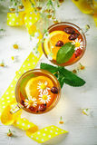 A healthy Cup of tea with lemon, rosehip, mint and flowers. Selective focus. Stock Photos