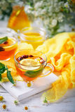 A healthy Cup of tea with lemon, rosehip, mint and flowers. Selective focus. Royalty Free Stock Photos