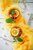 A healthy Cup of tea with lemon, rosehip, mint and flowers. Selective focus. Royalty Free Stock Photo