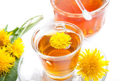 Healthy dandelion herbal tea and honey on white background. Healthy dandelion herbal tea on white background, with honey and blossoms, isolated stock image