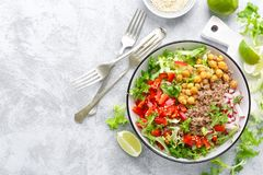 Healthy and delicious bowl with buckwheat and salad of chickpea, fresh pepper and lettuce leaves. Dietary balanced plant-based foo. D. Vegan and vegetarian dish stock photo