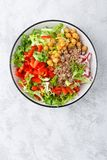 Healthy and delicious bowl with buckwheat and salad of chickpea, fresh pepper and lettuce leaves. Dietary balanced plant-based foo. D. Vegan and vegetarian dish stock image