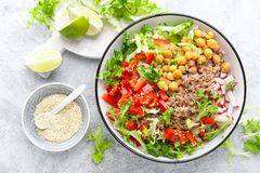 Healthy and delicious bowl with buckwheat and salad of chickpea, fresh pepper and lettuce leaves. Dietary balanced plant-based foo. D. Vegan and vegetarian dish royalty free stock photography