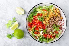 Healthy and delicious bowl with buckwheat and salad of chickpea, fresh pepper and lettuce leaves. Dietary balanced plant-based foo. Healthy and delicious bowl royalty free stock photos