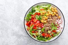 Healthy and delicious bowl with buckwheat and salad of chickpea, fresh pepper and lettuce leaves. Dietary balanced plant-based foo. Healthy and delicious bowl stock image