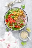 Healthy and delicious bowl with buckwheat and salad of chickpea, fresh pepper and lettuce leaves. Dietary balanced plant-based foo. D. Vegan and vegetarian dish stock images