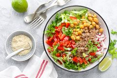 Healthy and delicious bowl with buckwheat and salad of chickpea, fresh pepper and lettuce leaves. Dietary balanced plant-based foo. Healthy and delicious bowl royalty free stock images