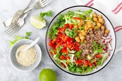 Healthy and delicious bowl with buckwheat and salad of chickpea, fresh pepper and lettuce leaves. Dietary balanced plant-based foo. Healthy and delicious bowl royalty free stock photography
