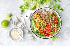 Healthy and delicious bowl with buckwheat and salad of chickpea, fresh pepper and lettuce leaves. Dietary balanced plant-based foo. Healthy and delicious bowl royalty free stock image